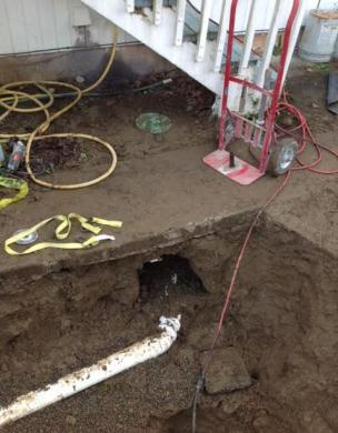 Sewer line exposed during an open trench replacement