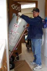 a tech delivers a new water heater